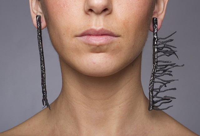 one-of-a-kind welded wire earrings composed of steel, black crepe paper and plastic dip that has been sprayed with lacquer