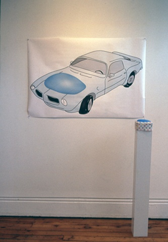 '1973 Trans Am with Silicone Buttock Implant, and Silicone Buttock Implant on Plinth with Fake Louis Vuitton Fabric Slipcover'