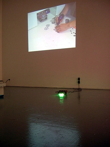 installation view: 'Wouldn't It Be (Ice, Ice)' showing 'Katie's Custom Car Shack' video