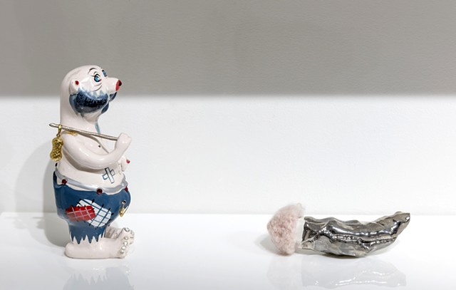 detail showing: 'Hideous vintage Kreiss ceramic hobo bear with replaced bindle stick and bag' and 'Untitled with vintage handknit mohair Barbie hat'
