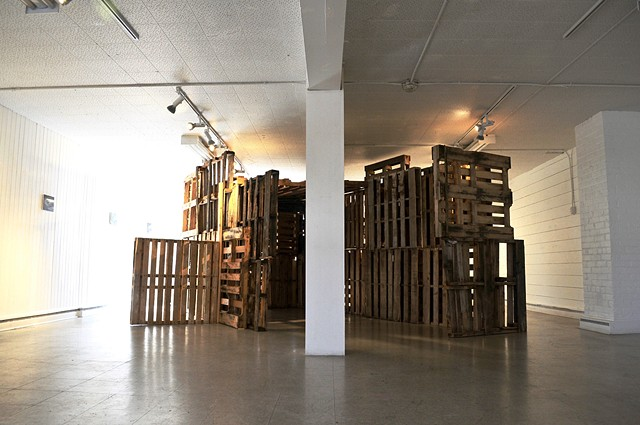 installation using painting and pallets society politics shelter home nomad bridge