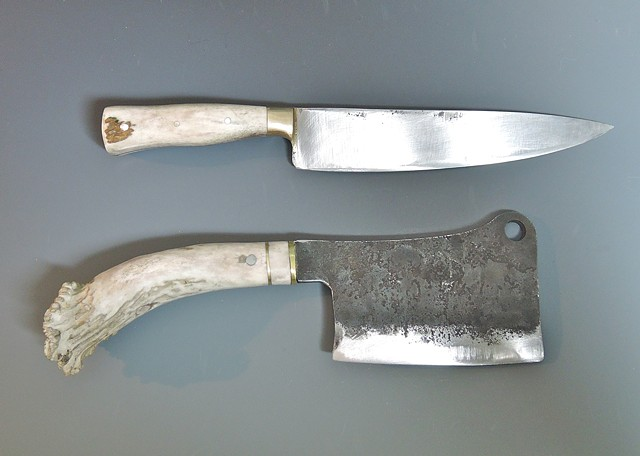 A stout meat cleaver with a whole antler crown handle