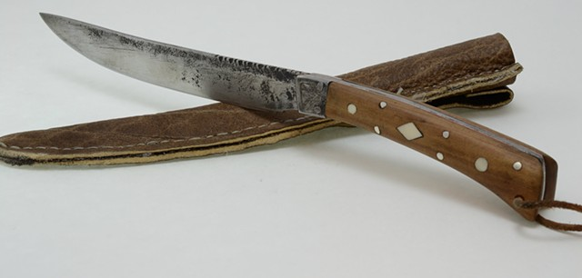 to me this knife has a very eastern feel with the back swept blade and forward swept handle