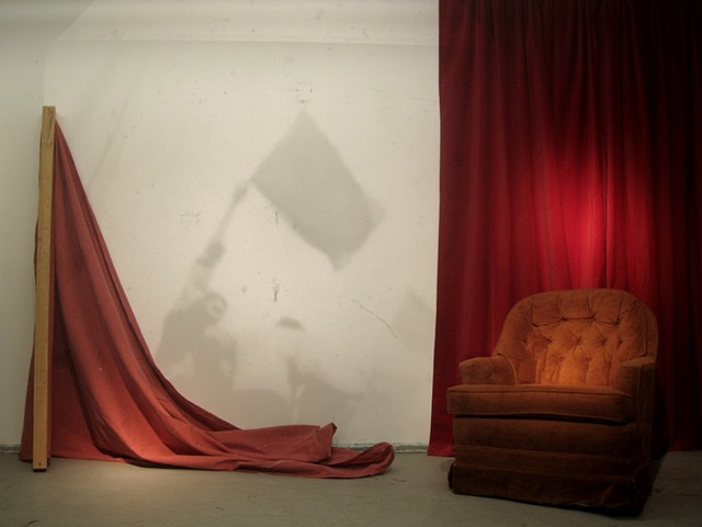 installation about nostalgia, red symbolizing communism but also referencing David Lynch with the red drapes, a domestic space occupied by a objects of a failed revolution