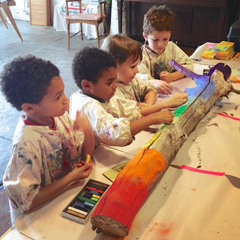 Children making chalk art, art classes for kids