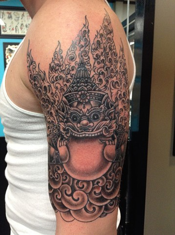 Tibetan Statue Tattoo by Mike Hutton