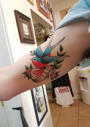 Custom Traditional Swallow with Heart and Flowers Color Tattoo By Ian Manley Washington DC