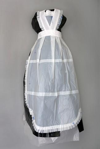 Mixed media maid's uniform sewn from Wal-Mart bags by Shara Rowley Plough.