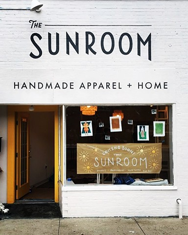 And painted logotype sign for The Sunroom Clintonville.