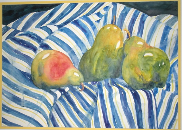 green pears resting on blue & white striped cloth