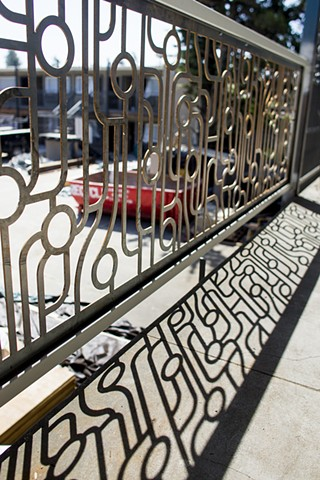 The Astro Circuit art panels make up 300' of balcony railings at the Astro Hotel in Santa Rosa, Ca.