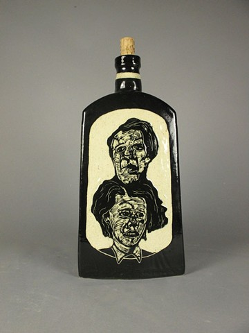 A double stack of heads is carved on each side of this ceramic bottle.