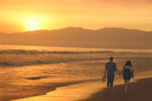Sunset walk on Santa Monica Beach by Richard Mann