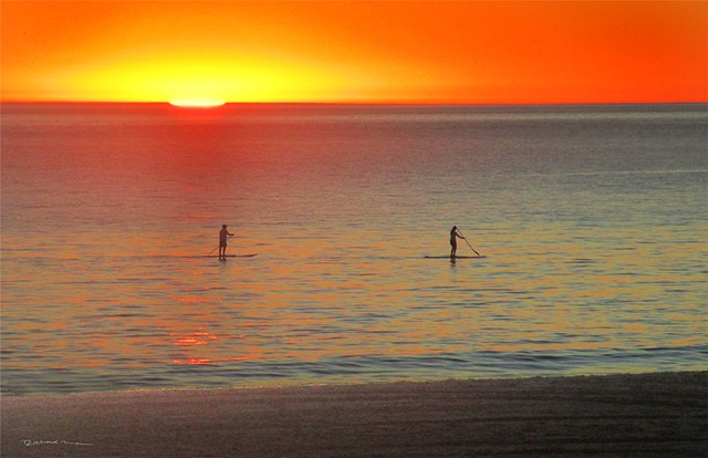 Stand up Paddleboarding  Malibu Beach Ca. Sunset in the Pacific Ocean