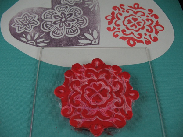gluing stamps to a plexiglass support makes them easy to place where you want them while stamping...