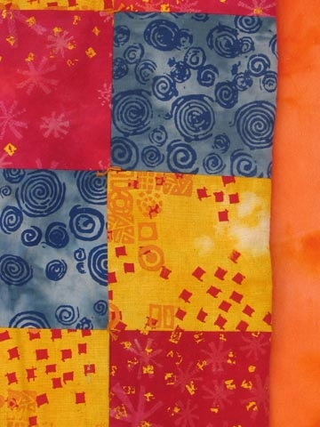 detail of a quilt made with dyed, screenprinted cottons