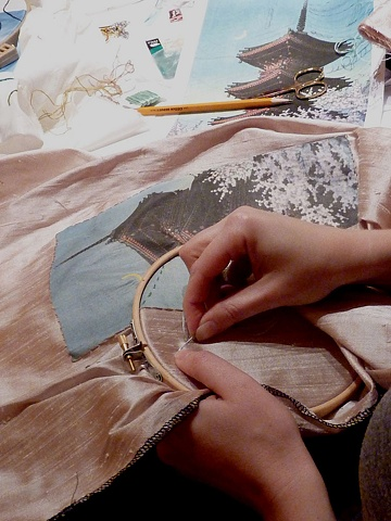 Kate stitching onto a silk dupioni background