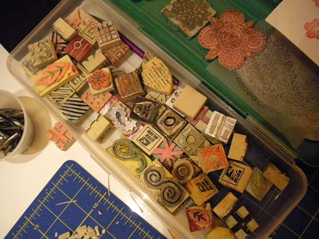 workbox full of hand-carved stamps