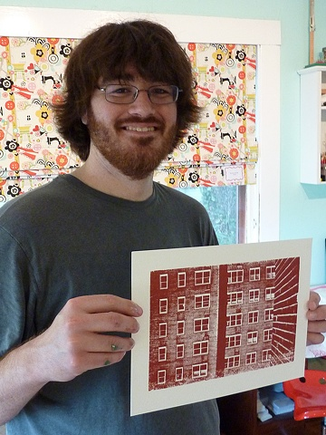 Thomas with his print on paper