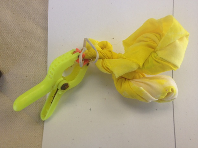 lemon yellow dyed fabric, twisted, clamped and ready for a complementary-color overdye in purple