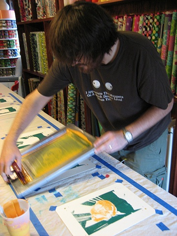 Screen Print Open Studio: Thomas experiments with multicolor printing on paper.