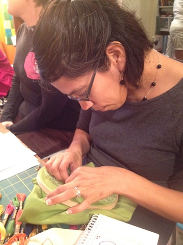 Magda works on a french knot.