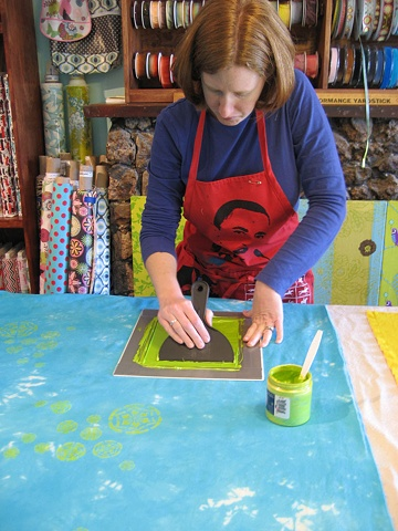 Kristin, printing a large piece of dyed cloth to make curtains