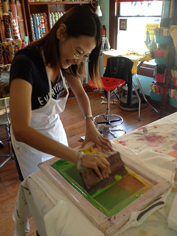 Yen printing her ombre stencil.