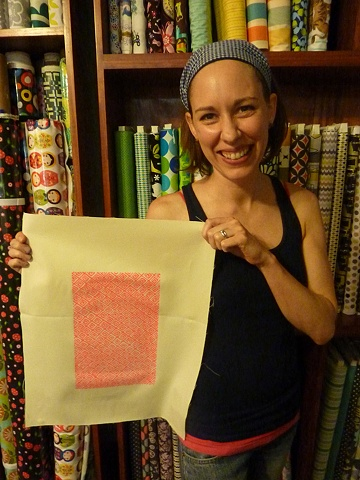 Christy with one of her prints.