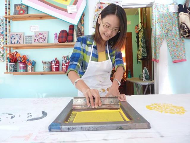 Yen printing one of her stencils.