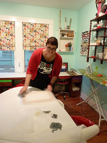 Kat stretching a silkscreen at Stitch Lab.