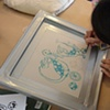 Yen creating a screen with drawing fluid.