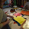 taking swatches of dyed fabric samples to use in a dye notebook -- a great reference for future work