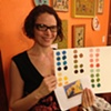 Laura with her final work: she identified the colors in an artwork, matched them in paper, and then mixed the colors in gouache!
