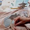 Kate stitching onto a silk dupioni background