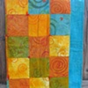 """citrus"" quilt, made with hand-dyed, silkscreened cotton fabric"