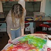 applying soy wax resist to dyed fabric, using a tjanting