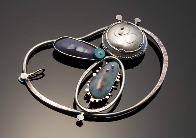 silver and enamel brooch with granulation