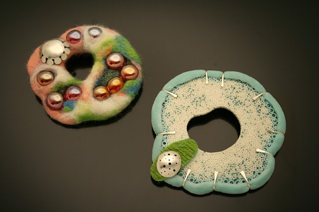 silver, resin, and wool brooches. Mixed media jewelry