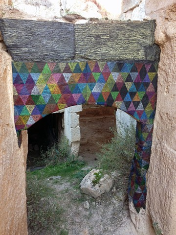 Temporary installation, paper on stone, Cappadocia, Turkey by Carmi Weingrod
