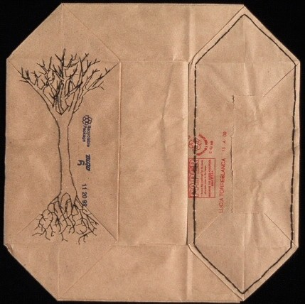 Stitched drawing of a tree on folded paper bags by Laura Evans