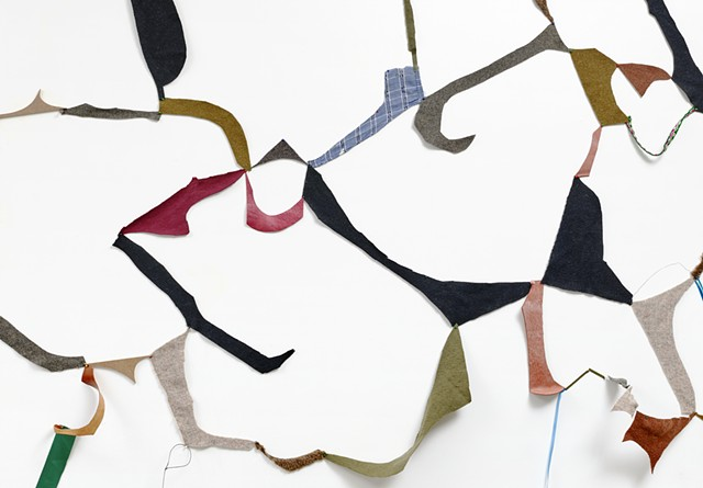 fabric remnants and mixed media in an abstract wall drawing, site-responsive