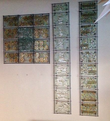 fused glass, mica, wire, and bead panels arranged in grids