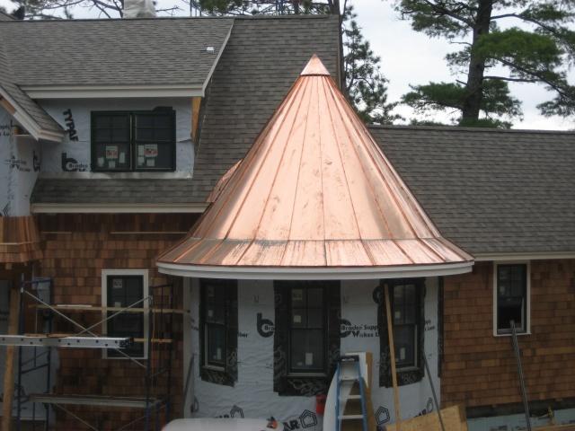 Coned roof still shiny.