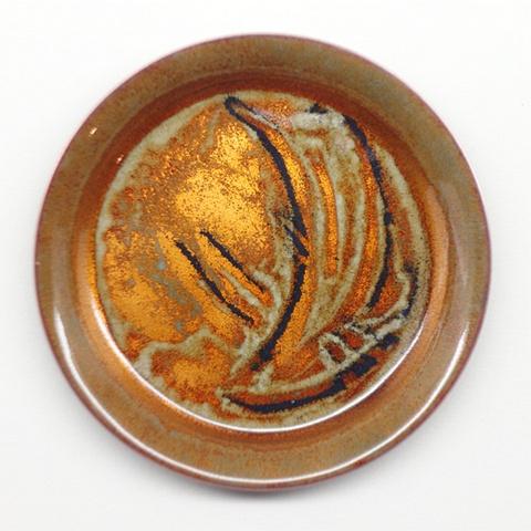 Copper enameled coasters.