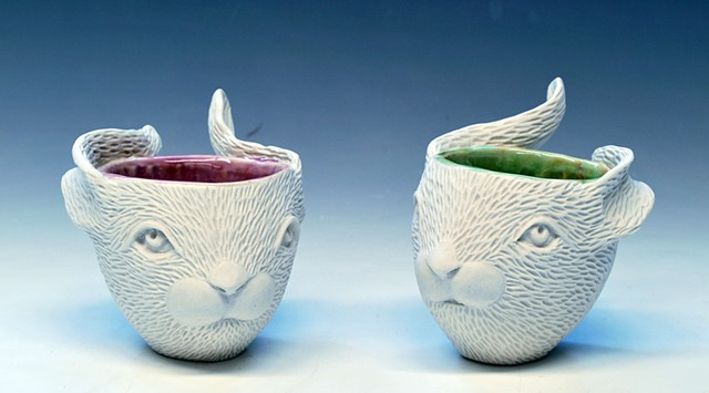 Coiled and hand carved rabbit head cups.