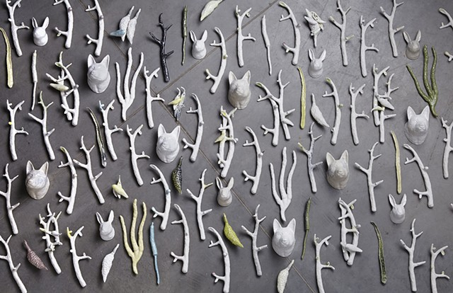 Slip cast, porcelain wall installation, incorporating branches, nature forms, birds, rabbits and wolves