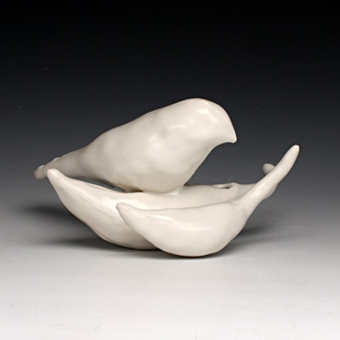 cast porcelain bird on seeds.