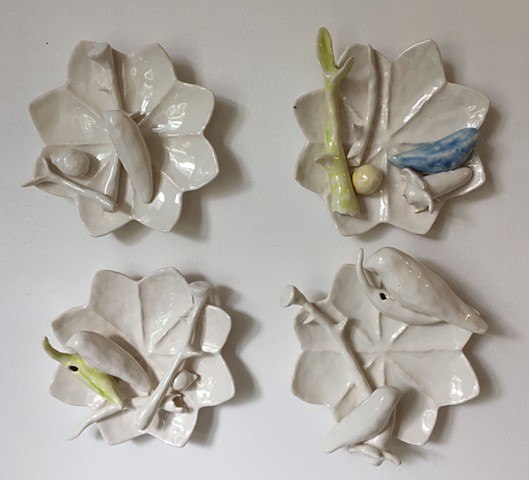 Cast porcelain wall forms with birds and branches