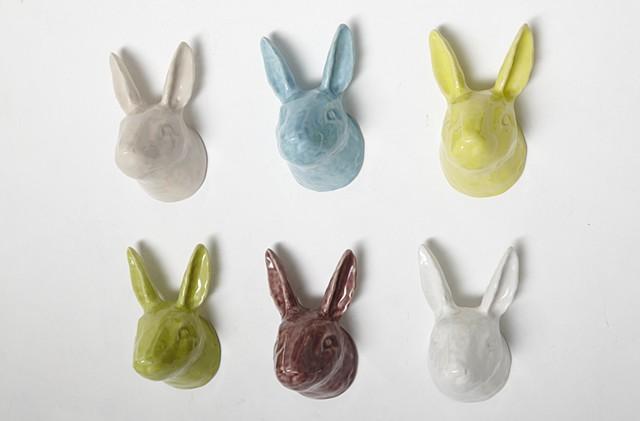 Cast porcelain rabbit heads.